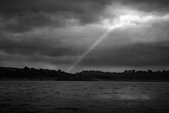 searchlight (Nick J Stone) Tags: ireland sky blackandwhite bw cloud sun storm monochrome rain weather clouds skyscape mono blackwhite lough ray eire loch sunbeam rayoflight derg weatherphotography justclouds therebeastormabrewin ©nickstone wethare