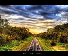 Lost Highway - HDR (:: Artie | Photography :: Offline for 3 Months) Tags: trees sky clouds photoshop canon highway cs2 tripod tracks kitlens overcast australia symmetry vegetation adelaide grasses express 1855mm southaustralia runway efs hdr artie 3xp buslanes photomatix tonemapping tonemap 400d rebelxti