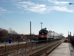 Northbound Metra commuter local arriving at the Forest Glen commuter flagstop depot. Chicago Illinois. January 2007.