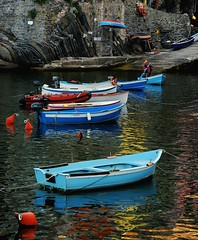 Signore del Mare (greg.gibb) Tags: travel blue sea italy reflection boats dawn fisherman nikon europe italia village it cinqueterre riomaggiore signore d80 greggibb