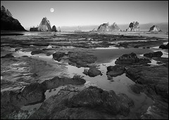 Shi Shi moonscape (reworked) (realkuhl) Tags: ocean copyright moon 20d water fog sunrise john rocks all  fullmoon rights lowtide reserved seastacks sigma1020mm landscapephotography shishibeach pointofarches lehmkuhl inpiring