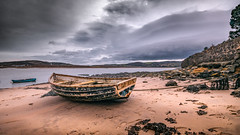 Castaway (Einir Wyn Leigh) Tags: boat island fish sea ocean water beach sand outdoor seascape deserted clouds storm colour colours abandoned alone digital llandscape nature natural light sky blue wreck coast
