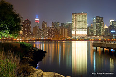 Nikon D50 (Rafakoy) Tags: nyc longexposure ny newyork color reflection water colors skyline night digital reflections cityscape manhattan nikond50 queens eastriver empirestatebuilding longislandcity gantryplazastatepark afnikkor2880mmf3356g