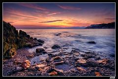 Cap Salou (Aitor Escauriaza) Tags: sunset sea sky beach d50 landscape sand nikon bravo rocks stones playa cel cielo cambrils rocas salou paintwithlight pedres naturesfinest sigma1020 supershot magicdonkey mywinners aitorescauriaza