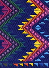 Popular Maya patterns on a piece of cloth, Guatemala (ali eminov) Tags: souvenirs maya guatemala textiles weaving fabrics fabricart tablerunners wovencloth wovenfabrics mayadesigns