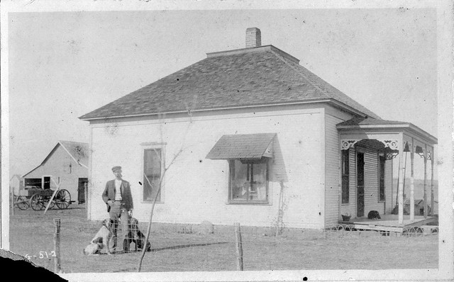 House, man, two dogs