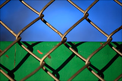 study in blue | green (♫ marc_l'esperance) Tags: blue light shadow blur color colour macro green colors metal vancouver contrast canon fence dark eos 3d raw colours dof bokeh space © rich chain chainlink illusion link 5d fencing shallow 2008 depth allrightsreserved cml gvrd iso125 canonef70200mmf28lusm