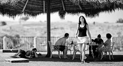 Under a Big Palapa (Luis Montemayor) Tags: blackandwhite woman house blancoynegro grass walking mexico casa mujer skirt dora pasto palapa brenda cuernavaca myfavs morelos caminando falda edelen armandoricalde