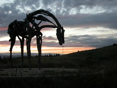 Sun setting behind a sculpture in the park near Google