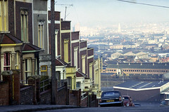 Totterdown, Bristol, 1974. (Fray Bentos) Tags: bristol cityscape view hill totterdown terracedhouses steepstreet