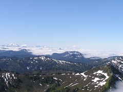 Clouds hanging in the valleys with Rainier in the distance