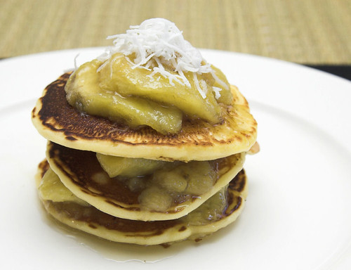 Coconut pancakes with bananas in palm sugar syrup