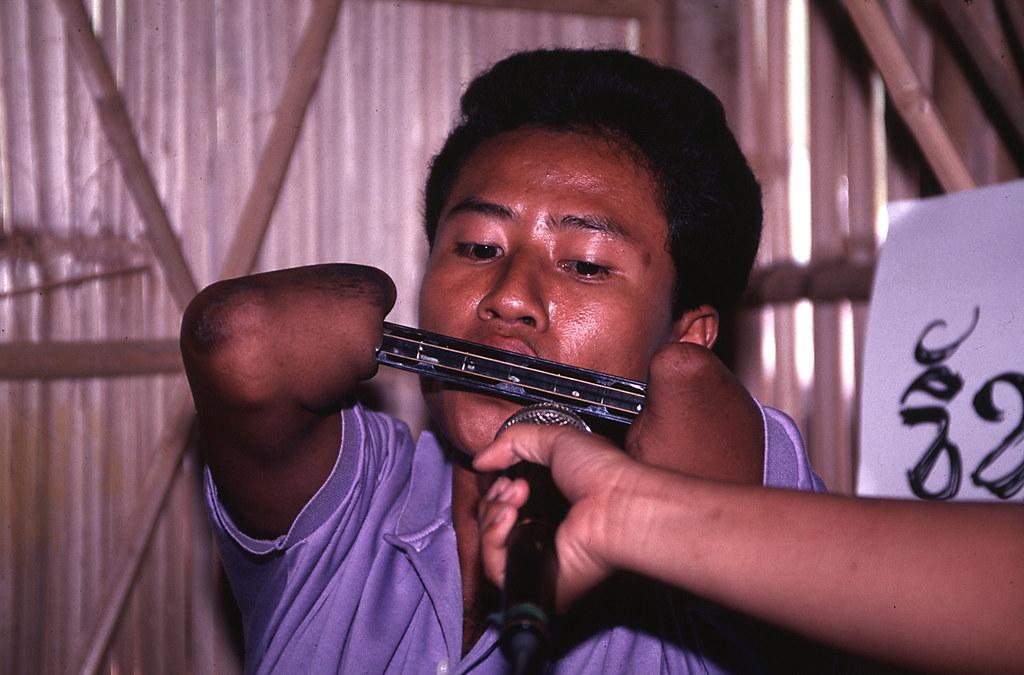 Landmine Victim Harmonica Player