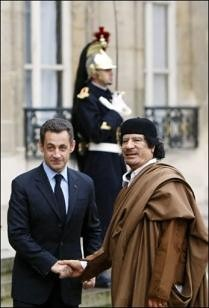 French President Sarkozy and Libyan leader Mummar Gadaffi during the North African head of state's visit to Paris. A deal was sealed involving arms and nuclear energy. Today France is bombing the country and has sent military advisors. by Pan-African News Wire File Photos