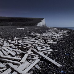 Eight thousand planks, Seven sisters and the Moon (Alex Bamford) Tags: longexposure moon beach night timber pebbles fullmoon moonlit moonlight sevensisters planks whitecliffs moonlighting jetsom cuckmerehaven alexbamford thebigbambooly iceprince wwwalexbamfordcom
