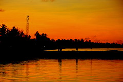 Today's Sunset Over Feydhoo (Fasy.) Tags: city sunset canon lens eos gold jetty through maldives ahmed addu feydhoo faseeh 40d fasy1