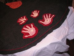 glue the handprints to the grey felt