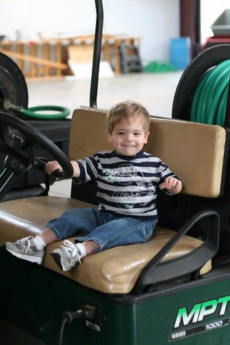 """Walker """"Driving"""" the Golf Cart"""