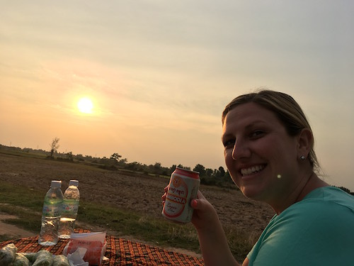A girl, her beer and the sunset