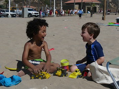 Making each other laugh (Anika Malone) Tags: people sun beach sand dockweiler friendfeed friendfeedmeetup