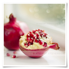 Powerful pomegranate (Stuart Stevenson) Tags: autumn red stilllife fall window rain fruit canon 50mm juicy healthy asia canon300d 14 pomegranate naturallight stuart raindrops cmwdweeklywinner stuartstevenson apinchoftexture stuartstevenson