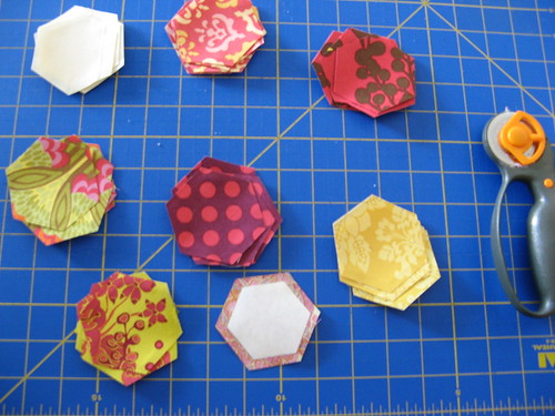 hexagons cut out with freezer paper back