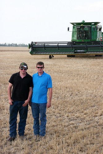 James and Leon take time for a photo op while Rolly parks his combine
