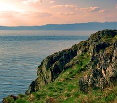 Where the Winds Blow (Frøkenfryd) Tags: pink blue light sea sky cliff sunlight green norway clouds spring rocks view may trondheim korsvika nikond40 frøkenfryd