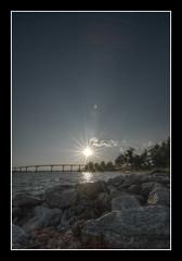 An interlude (Tim Serge) Tags: sunset sun nikon rocks hdr sunstar southernmaryland calvertcounty solomonsisland nikond80 qtpfsgui thomasjohnsonmemorialbridge tokina1116mmf28 atx116prodx 9bladeaperture nprsummer