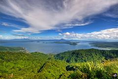 Taal Lake Viewed From Tagaytay [1] ([ Rodelicious ]) Tags: ocean trip travel blue light sea vacation sky sun color colour art beach nature beautiful beauty smile clouds contrast photoshop canon landscape geotagged photography volcano photo interestingness exposure dof photos philippines explore pk tagaytay taal canoneos hdr highdynamicrange hdri blending waterscape rodel sigma1020mm mabuhay photomatix tonemap canon400d canonxti colorphotoaward aplusphoto pinoykodakero colourartaward perfectescapes rodelicious ifolio garbongbisaya rodeljoselitomanabat gettyimagesphilippinesq1 gettyimagesasia gettyimagesphilippines