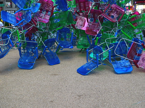 a sculpture of lawn chairs