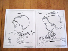 Caricatures of Owen playing the ukelele and Aki riding the tricycle
