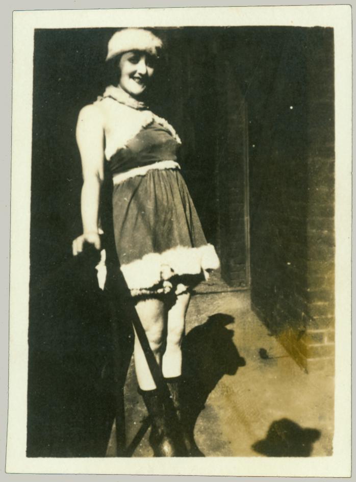 girl on steps in costume