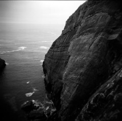 this is the sea (Sen Venn) Tags: cliff seascape west rock holga cork ilford fp4 120n xtol threecastleshead