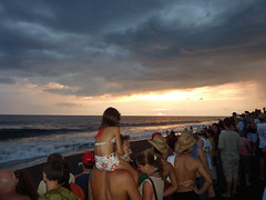 The sun setting over the sea and a sea of people!