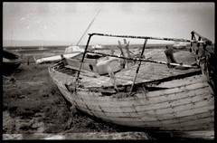 heswall-beach (liz platt) Tags: beach boats shipwreck hp5 ilford decaying wirral heswall handprocessed blackandwhitefilm pentaxp30n beachedship decayingship