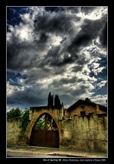 Porta misteriosa (HDR) (scar Garriga) Tags: barcelona door cloud clouds puerta gate sony catalonia nubes porta catalunya alpha hdr nube mistery misterioso misterious nuvol nuvols misterios a700 santsadurndanoia