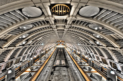 Intergalactic Bus Tunnel (Surrealize) Tags: seattle orange white bus public station metal architecture bronze underground subway washington nikon downtown track ship artistic metro steel space rail tunnel symmetry transit scifi mass subterranean hdr futuristic intergalactic spaceage airduct 14mm d700 centrallink pioneersquarestation surrealize seattlelinklightrail