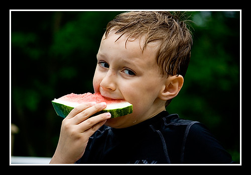 Campbell eating watermelon.