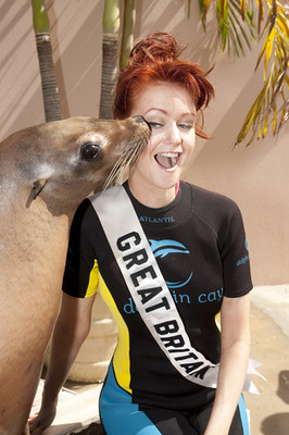 Cassie the Sea Lion kisses Clair Cooper