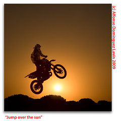 Jump over the sun (Alfonso Domnguez Lavn) Tags: light sky orange sun luz sol bike contraluz jump nikon all shadows motorbike blacklight filter rights cielo moto salto motor effect motocross naranja sombras reserved copyrighted cokin nikond40 wwwalfonsodominguezes alfonsodominguez fotodelaofdv