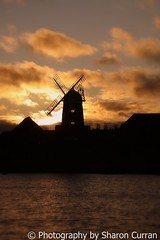 Windmill at Caldecotte - (Explored) (Photography by Sharon Curran) Tags: sunset shadow orange sun lake building water windmill silhouette clouds miltonkeynes ripple buckinghamshire 1785mm blades tattenhoe shepherdsdelight caldecottelake mkflickrites canon40d