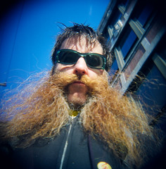 88420005 (dogseat) Tags: cameraphone me beard glasses ginger holga eyecontact ishootfilm messy redbeard sideburns 365 dogseat beardo muttonchops scraggly project365 sidewhiskers phonecamseat 365days dundrearies 151365
