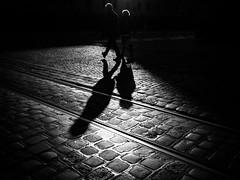 shadow play (Sandy...J) Tags: olympus streetphotography sw shadow light people walking monochrom blackwhite bw urban city cobblestones atmosphere darkness