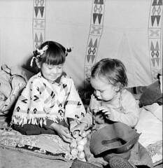 Alex One Spot and his sister Linda from the Tsuut'ina First Nation in a teepee during the Calgary Stampede, Alberta / Alex One Spot et sa sœur Linda de la Première Nation Tsuut'ina dans un tipi lors du Stampede de Calgary (Alberta) (BiblioArchives / LibraryArchives) Tags: lac bac libraryandarchivescanada bibliothèqueetarchivescanada canada canada150 alberta jacklong calgary july1945 juillet1945 calgarystampede stampededecalgary teepeevillage villageteepee alexonespot lindaonespot tsuutinanation nationtsuutina firstnations premièresnations children enfants girl fille boy garçon nationalfilmboardcanada officenationaldufilmducanada