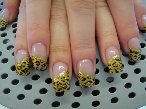 French manicure with wild leopart nail design motives