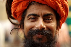 smiling sadhu | Kolkata (arnabchat) Tags: portrait india face look eyes dof turban favs kolkata bengal calcutta bangla pilgrim sadhu saffron pilgrims westbengal 50f18 pagri canon400d arnabchat arnabchatterjee gangasagartransitcamp kwsgangasagarcamp110109