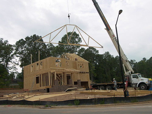 Putting trusses on a newly framed home