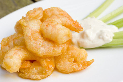 Buffalo Shrimp with celery and blue cheese dip 12