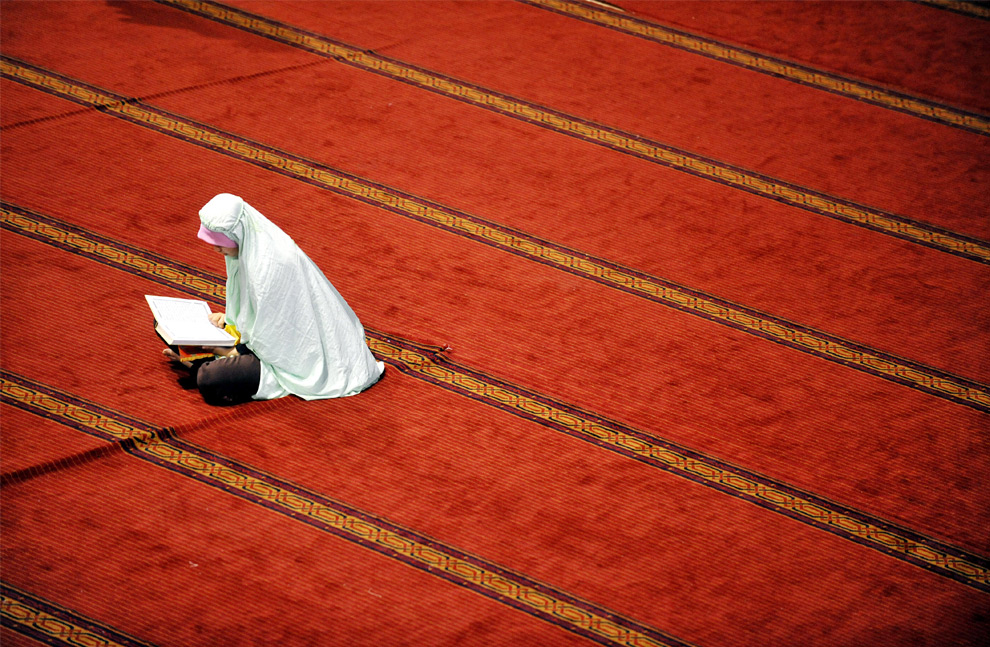 A Muslim woman prays at the Istiqlal mosque on the first day of the holy fasting month of Ramadan in Jakarta